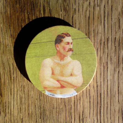 Strongman brooch