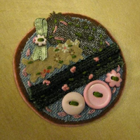 green cornelli brooch