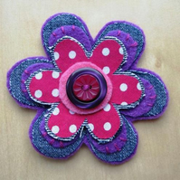 purple button brooch