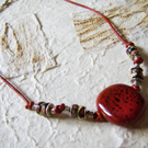 Paprika – Red ceramic, polymer clay and leather necklace