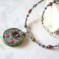 'Ring of roses' – Red, blue and green faux cloisonné necklace