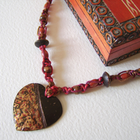 'Wooden Heart' – Macrame necklace with handpainted coconut shell centrepiece.