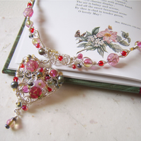 'Wild at Heart' Pink heart shaped necklace with beads and freshwater pearls