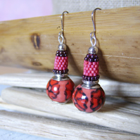 'Carmina' Red and black ceramic flower earrings with woven detail