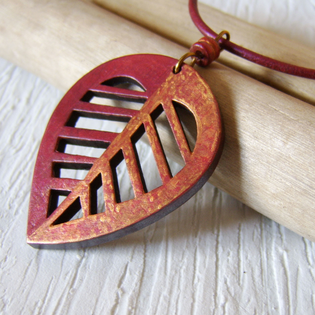 Copper and gold handpainted wooden leaf pendant on hand dyed leather cord