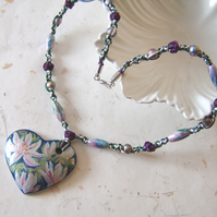 'Magnolia' Wooden heart necklace with handpainted pink flowers on a macramé cord
