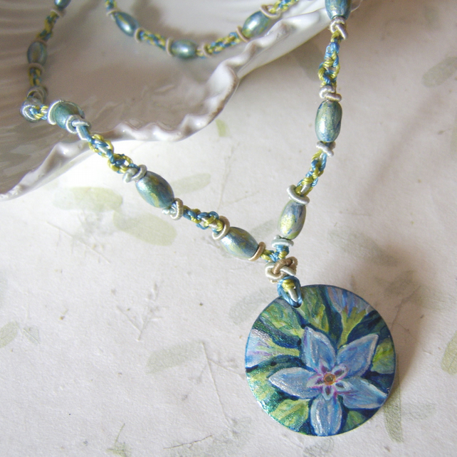 'Periwinkle' Blue and green flower painted wooden pendant on a macramé cord