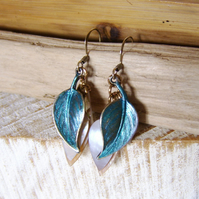 'Peacock Leaf' blue patinated metal leaf earrings with mother of pearl
