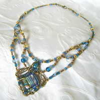 'Celestine' Blue and gold wirewrapped necklace with dichroic glass cabochon