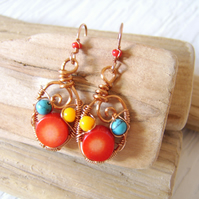 Brightly coloured wirewrapped sea bamboo earrings in red, yellow and turquoise