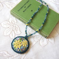 Nature inspired yellow and blue wild flower necklace