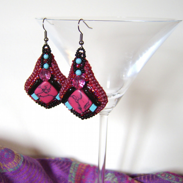 Art Deco inspired hot pink and black beaded earrings with turquoise gemstones