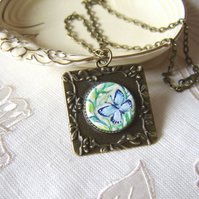 Blue butterfly pendant painted in miniature on wood