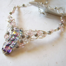 Fairy wings necklace with woven wire and iridescent glass