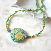 Buttercup necklace with handpainted wild flowers, glass beads and macramé