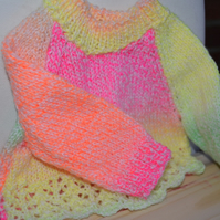 Hand knitted bright baby jumper 3-6mnths