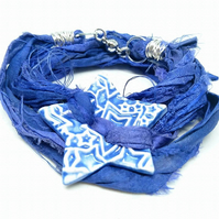 Blue sari silk bracelet with ceramic star button and magnetic clasp