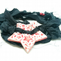 Black sari silk bracelet with red ceramic star button and magnetic clasp