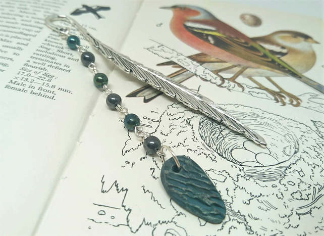 Feather bookmark with ceramic charm and metallic look beads