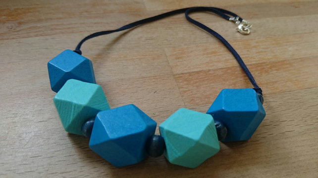 Chunky wooden geometric necklace in navy, blue and aqua
