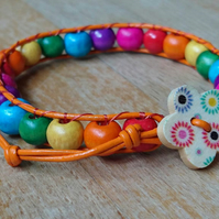 Rainbow coloured wooden bead and orange leather bracelet