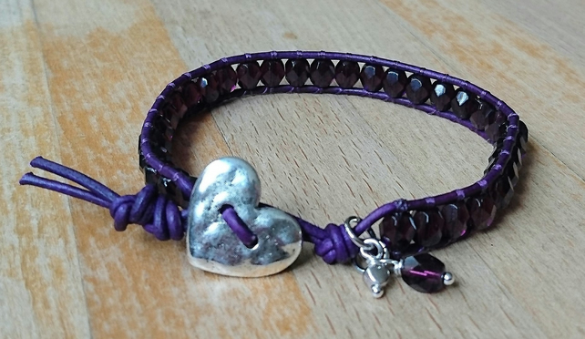Purple leather and glass bead bracelet with heart button