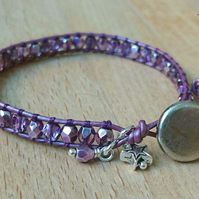 Purple metallic leather and glass bead bracelet with silver button