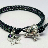 Black leather and purple bead bracelet with skull button