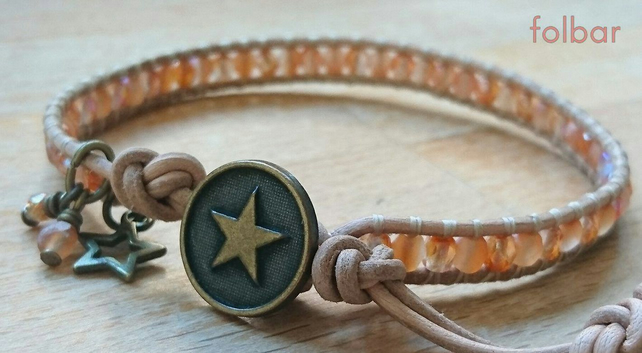 Tan leather and peach glass bead bracelet with star button