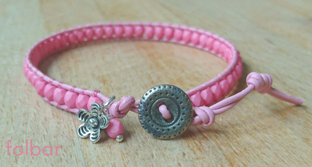 Pale pink leather and glass bead bracelet with button fastener