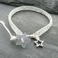 Silver and white leather and glass bead bracelet with glittery star button
