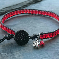 Black leather and red beaded bracelet