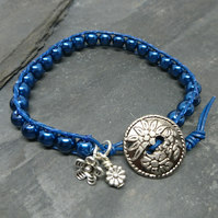 Navy leather and glass pearl bracelet with floral button