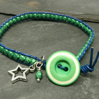 Navy leather and metallic green glass bead bracelet with green vintage button