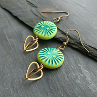 Green sunburst disc bead and 3d heart charm earrings