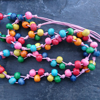 Rainbow wooden necklace on pale pink cotton cord