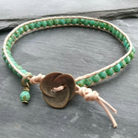 Champagne metallic leather and green faceted glass bead bracelet, flower button