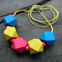 Bright pink, blue and yellow chunky geometric wooden necklace
