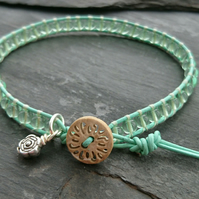 Fresh green leather and glass bead bracelet, wooden button, flower charm