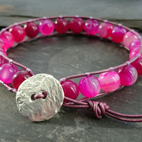 Pink striped agate bead and leather bracelet