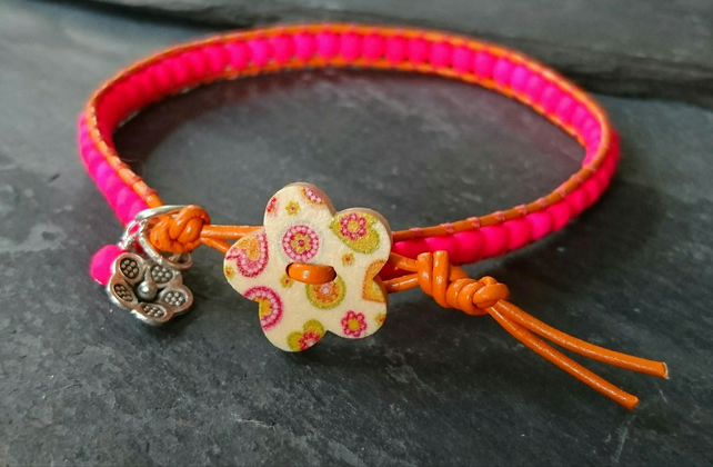 Bright orange leather and neon pink bracelet with wooden flower button
