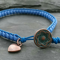 Blue leather and glass bead bracelet with copper button and heart charm