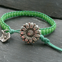 Green leather and glass bead bracelet with flower button and charm