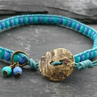 Blue and green leather and beaded bracelet with antique gold button