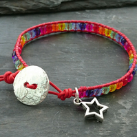 Red leather and rainbow glass bead bracelet with silver button and star charm