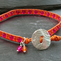 Orange and hot pink leather beaded bracelet with silver button