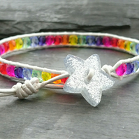 Rainbow bracelet with silver leather cord and glittery star button