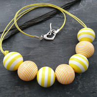 Yellow and white striped round acrylic bead necklace, heart shaped clasp