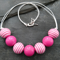 Pink and white striped round acrylic bead necklace, heart shaped clasp