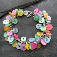 Pastel button bracelet, pink, blue, green and yellow buttons